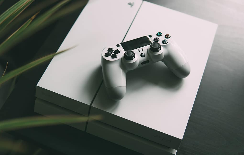 Picture of game console controller on top of game console