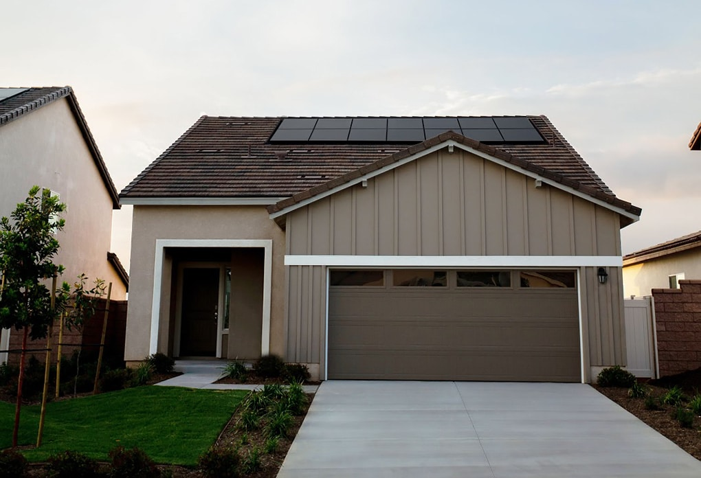 Picture of house with solar panels installed at the top
