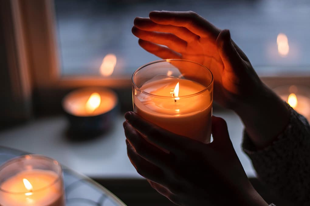 Picture of a boy holding a candle during a blackout